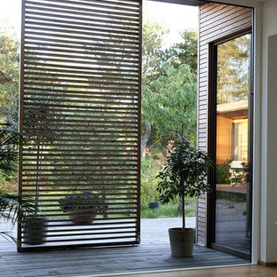 Inspiration for a large zen two-story exterior home remodel in Other
