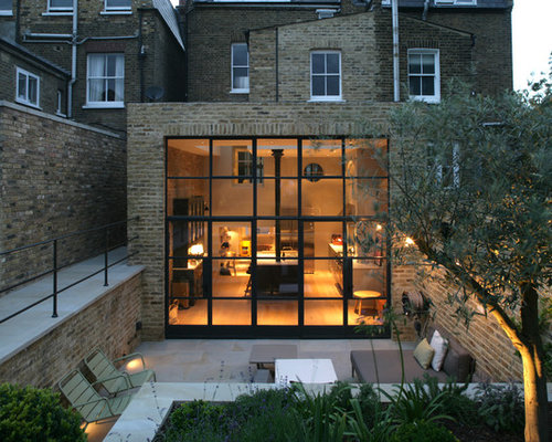 Contemporary two story brick exterior home idea in london