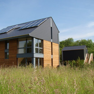 Inspiration for a modern three-story wood exterior home remodel in Buckinghamshire