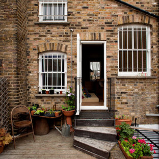 Example of a mountain style brown brick exterior home design in London