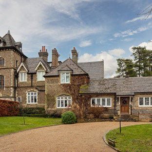 Inspiration for a large and brown victorian detached house in Other with three floors, stone cladding, a hip roof and a shingle roof.