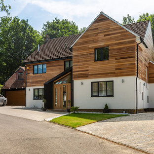 Inspiration for a large and brown traditional detached house in Essex with three floors, mixed cladding, a pitched roof and a tiled roof.