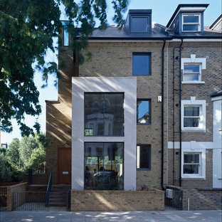 Trendy brick exterior home photo in London