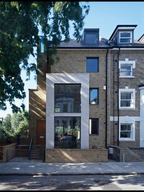 Trendy brick exterior home photo in London