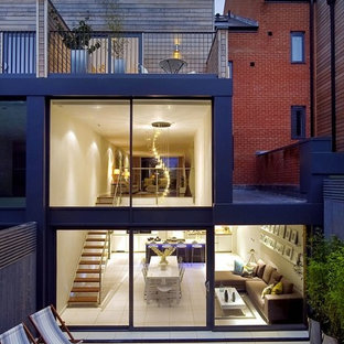 Design ideas for a modern exterior in London with three or more floors.