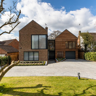 Inspiration for a large contemporary two floor detached house in Surrey with mixed cladding and a pitched roof.