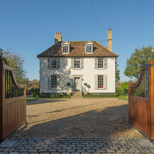 Large and white classic two floor detached house in Cambridgeshire with a hip roof.