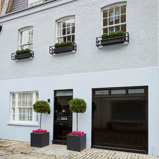 Medium sized and gey traditional exterior in London with three or more floors and mixed cladding.