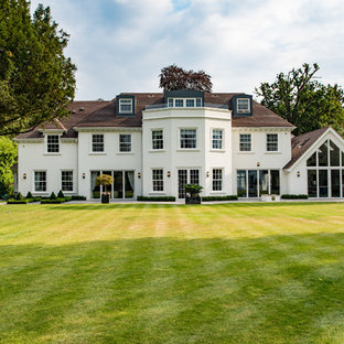 Inspiration for a white classic two floor render detached house in Buckinghamshire with a hip roof and a shingle roof.