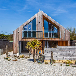 Inspiration for a brown rural two floor detached house in Sussex with wood cladding and a pitched roof.