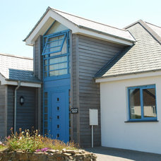 Beach Style Exterior by The Bazeley Partnership