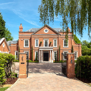 Photo of a traditional brick red exterior in Surrey with three or more storeys.