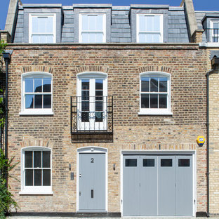 Photo of a contemporary brick exterior in London with three floors.