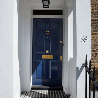 Inspiration for a large traditional brick blue townhouse exterior in London.