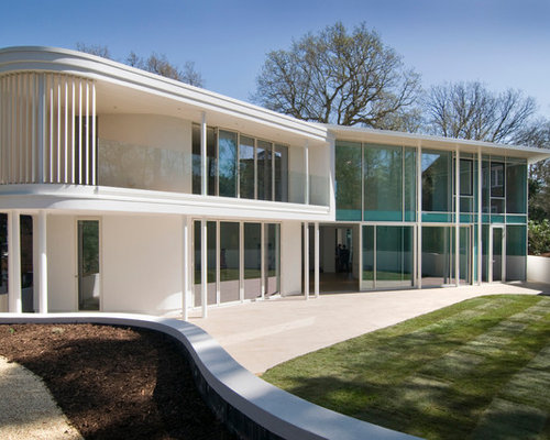 This Is An Example Of A White Modern Two Floor Glass Exterior In London.
