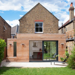Design ideas for a medium sized and brown contemporary one floor exterior in London with mixed cladding.