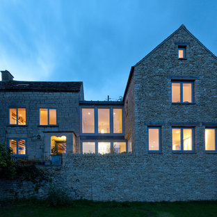 Large rural two floor exterior in Gloucestershire with stone cladding and a pitched roof.