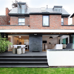 Inspiration for a medium sized contemporary two floor brick exterior in Manchester with a hip roof.