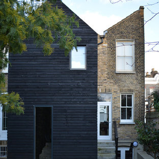 Inspiration for a mid-sized contemporary two-story mixed siding duplex exterior remodel in London