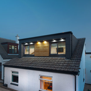 Inspiration for a mid-sized contemporary two-storey exterior in Glasgow with wood siding.