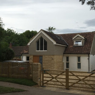 This is an example of a multi-coloured rural two floor detached house in Other with mixed cladding, a pitched roof and a tiled roof.