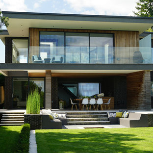 Inspiration for a large and multi-coloured contemporary two floor detached house in Hampshire with mixed cladding and a flat roof.