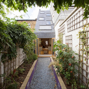 Example of a small trendy exterior home design in London