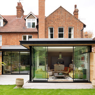 Inspiration for a modern two floor brick exterior in Cheshire.