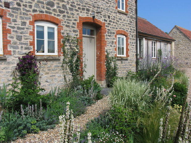 Traditional House Exterior by Charlotte  Rowe Garden Design