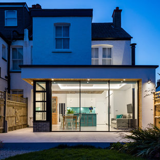 White contemporary render semi-detached house in London with a flat roof.