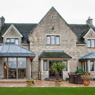 Inspiration for a large and brown classic exterior in Oxfordshire with stone cladding, a pitched roof and a shingle roof.