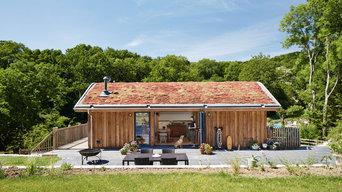Sustainable family house nestled into surrounding countryside