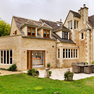Example of a large classic beige three-story stone exterior home design in Oxfordshire