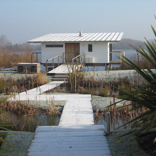 Inspiration for a small midcentury one floor exterior in Hampshire with a lean-to roof.