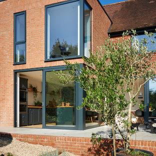 Mid-sized scandinavian two-story brick duplex exterior idea in Hampshire