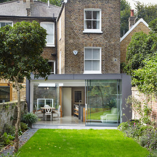 Design ideas for a contemporary brick exterior in London with three or more floors and a flat roof.