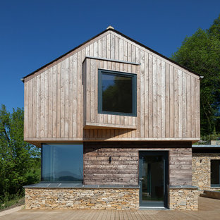Inspiration for a medium sized contemporary two floor exterior in Gloucestershire with mixed cladding and a pitched roof.