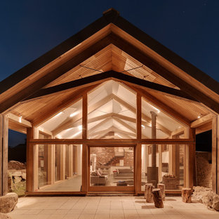 This is an example of a contemporary exterior in Devon with mixed siding and a gable roof.