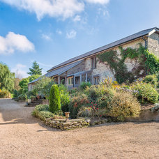 Farmhouse Exterior by Colin Cadle Photography