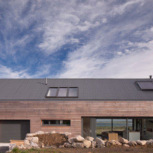 Inspiration for a contemporary one floor exterior in Other with wood cladding and a pitched roof.