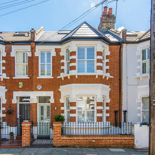 Inspiration for a medium sized classic two floor brick exterior in London with a pitched roof.