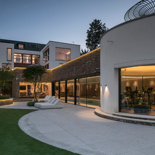 Design ideas for an expansive and white contemporary exterior in Berkshire with three or more floors, mixed cladding and a flat roof.