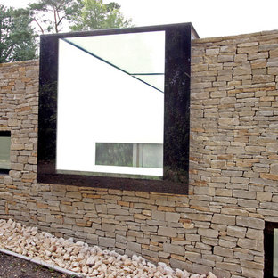 Inspiration for a large modern stone exterior home remodel in London