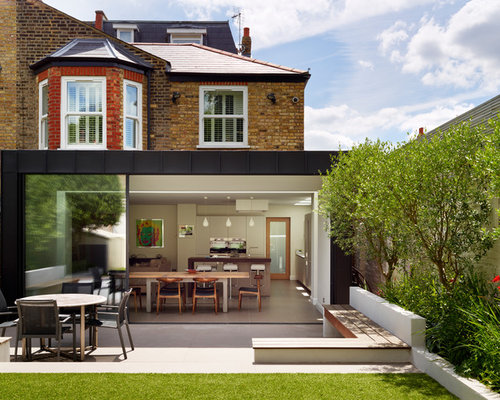 Contemporary Brown Three Story Brick Exterior Home Idea In London
