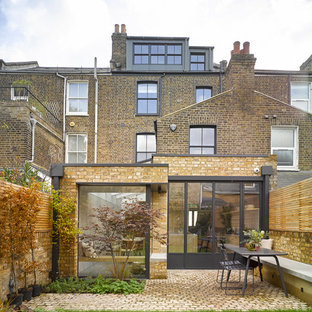Contemporary brick house exterior in London with three floors.