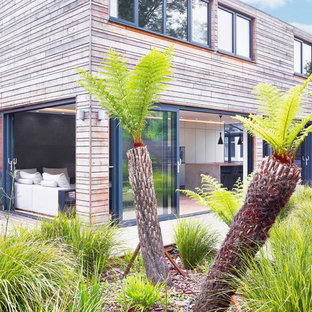 Inspiration for a mid-sized modern gray two-story wood exterior home remodel in Devon with a metal roof
