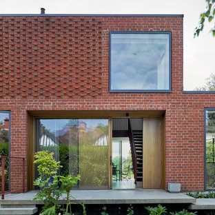 Inspiration for a medium sized and red contemporary two floor exterior in Buckinghamshire with a flat roof.