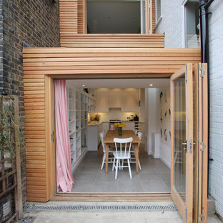 Inspiration for a contemporary two-story wood exterior home remodel in London