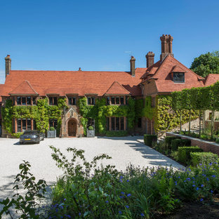 Photo of an expansive and red traditional brick house exterior in Oxfordshire with three floors.