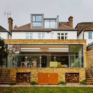 This is an example of a white contemporary detached house in Surrey.